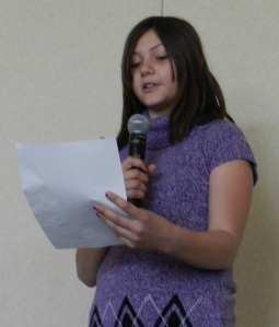 "Becca reads her onomatopoeia poem ""Autumn Hunter"""
