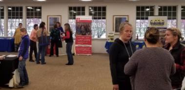 Exhibitors talking to participants, 2019